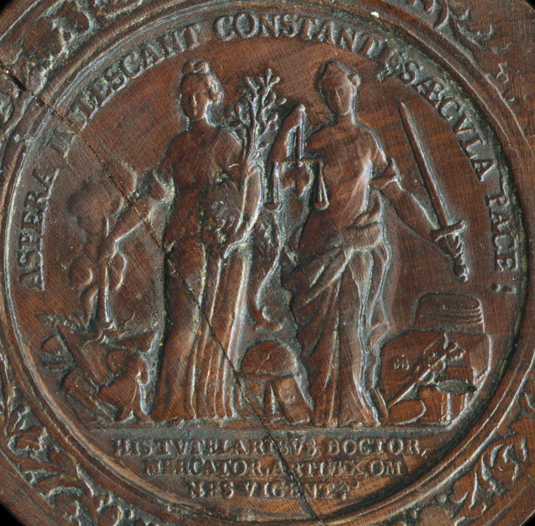 Spielstein mit Nürnberg Stadtansicht von Osten und Friedensallegorie Spielsteinseite mit Allegorie Pax und Justitia, Detail