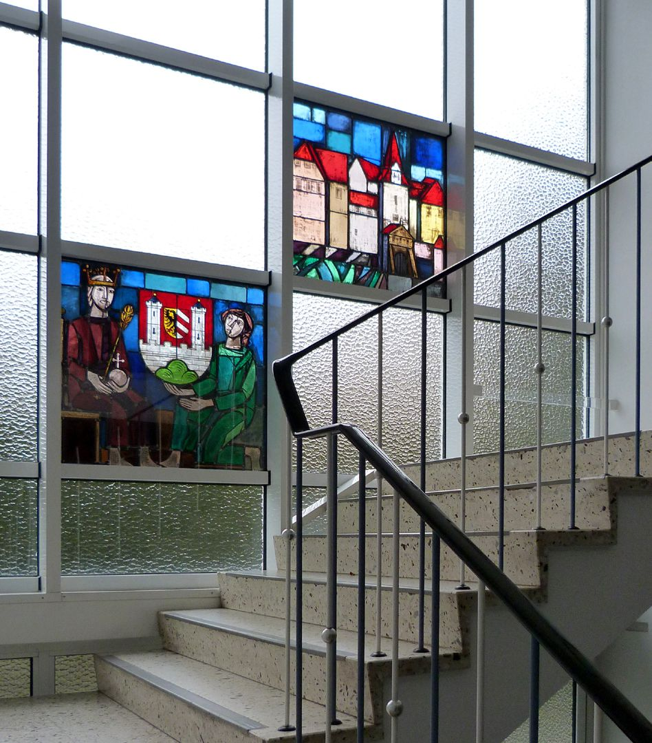 Stained glass windows on the city history Staircase to the first floor