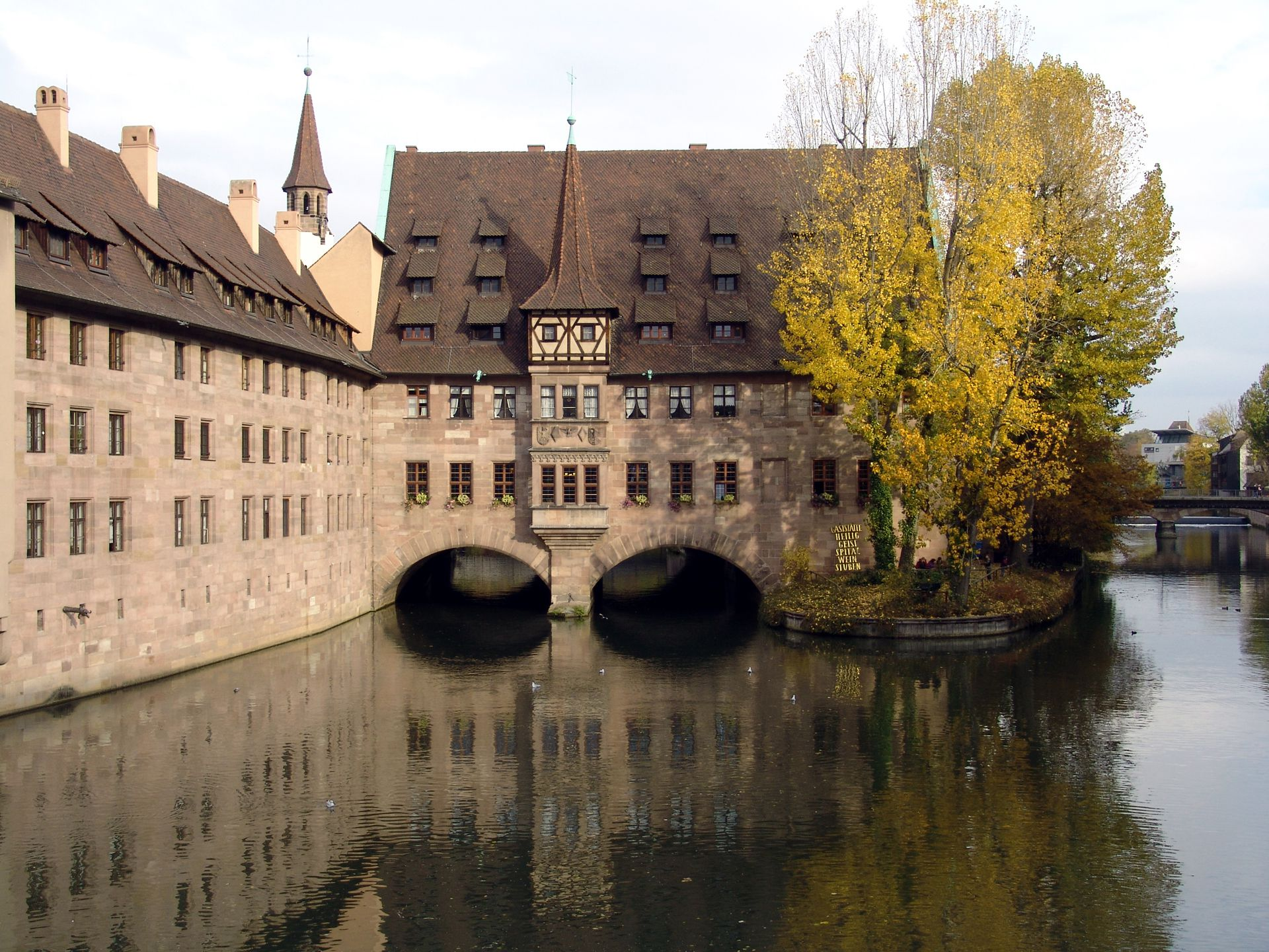 Hospice of the Holy Spirit Building spanning the river Pegnitz, originally communal ward for the invalids and ill persons (now a restaurant)