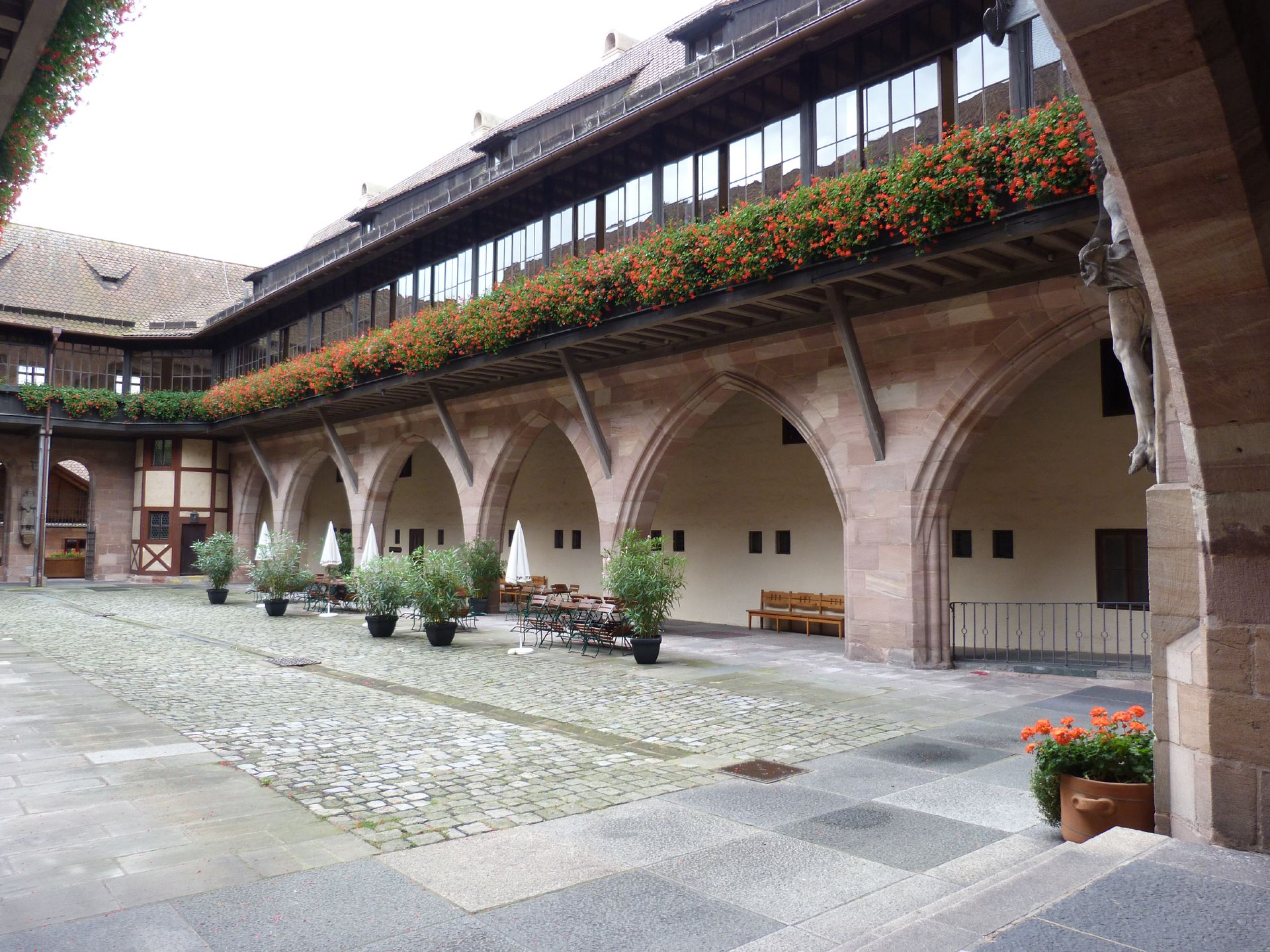 Hospice of the Holy Spirit Courtyard with arcades, arches with walkway galleries designed and positioned as a bridge spanning the river Pegnitz