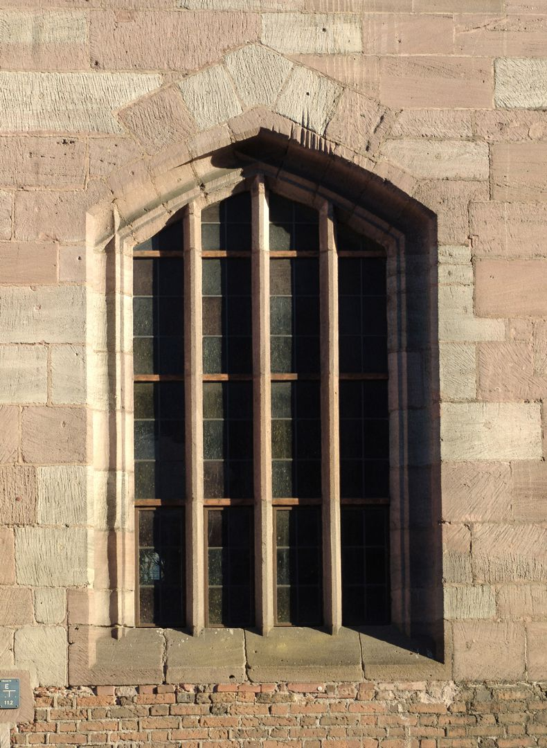 Hospice of the Holy Spirit North front, window with pointed cornered arches