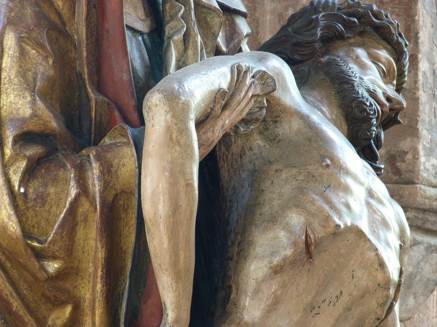 Great Pietà Mary holds the right arm of Jesus