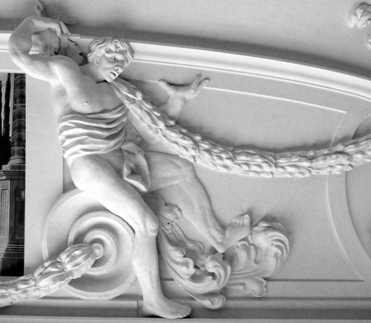 Stucco ceiling from the garden hall of the former Merkel estate Man with a garland sitting on a volute in the north east part of the ceiling