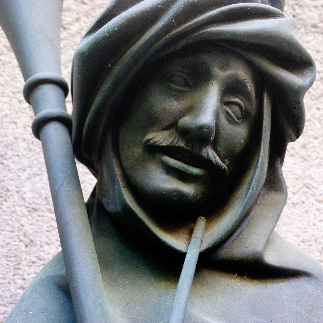 Dudelsackpfeiferbrunnen Gesicht