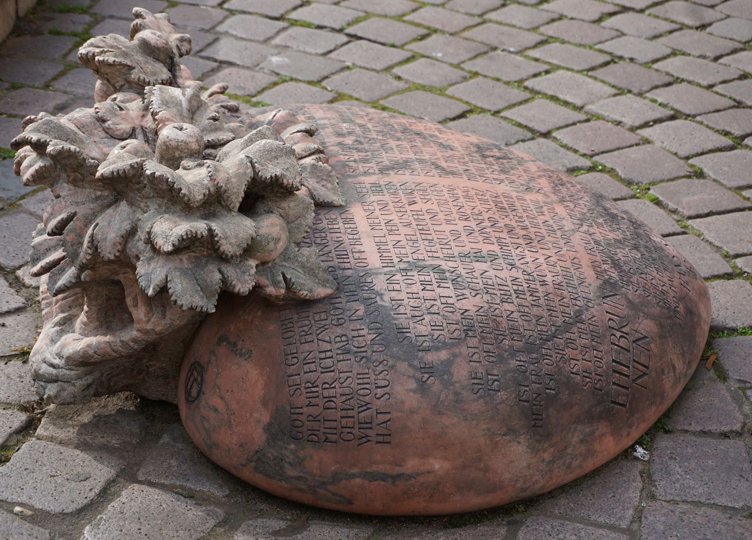 """Marriage carousel/ Hans Sachs Fountain """"The heart as a popular symbol of love is inlaid in the pavement of Ludwigsplatz like a tombstone. (J.W"""