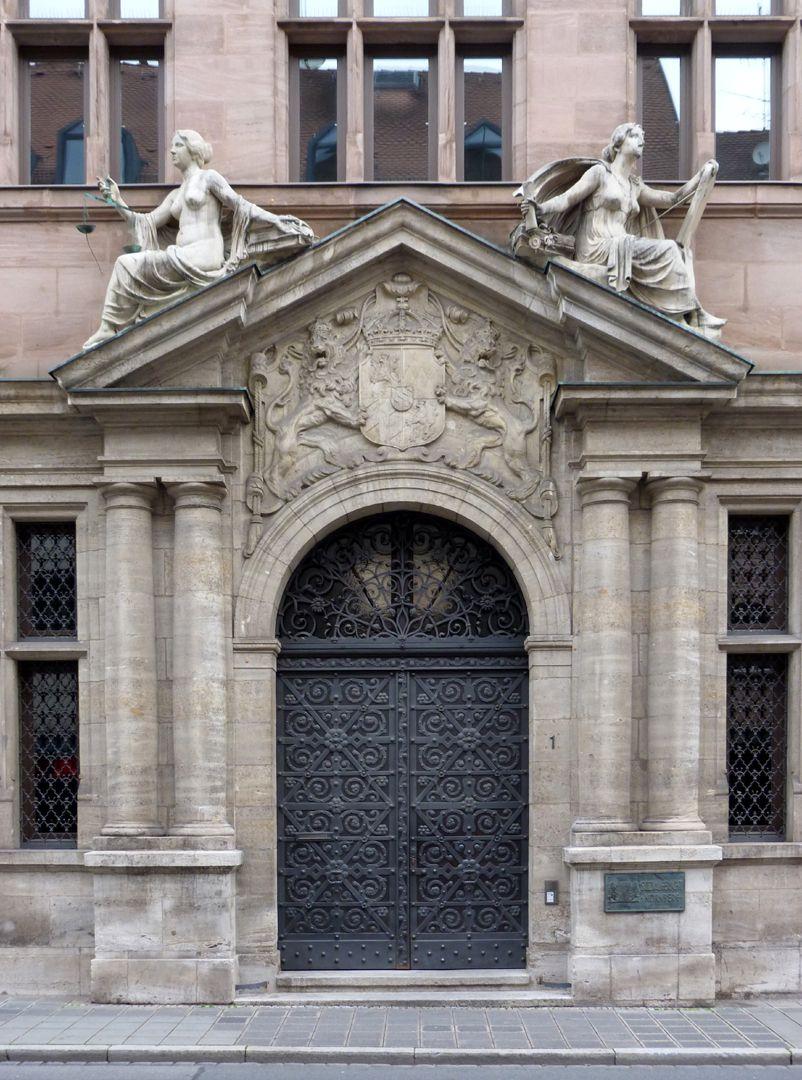 Social Court Entrance, stone figures by Philipp Kittler