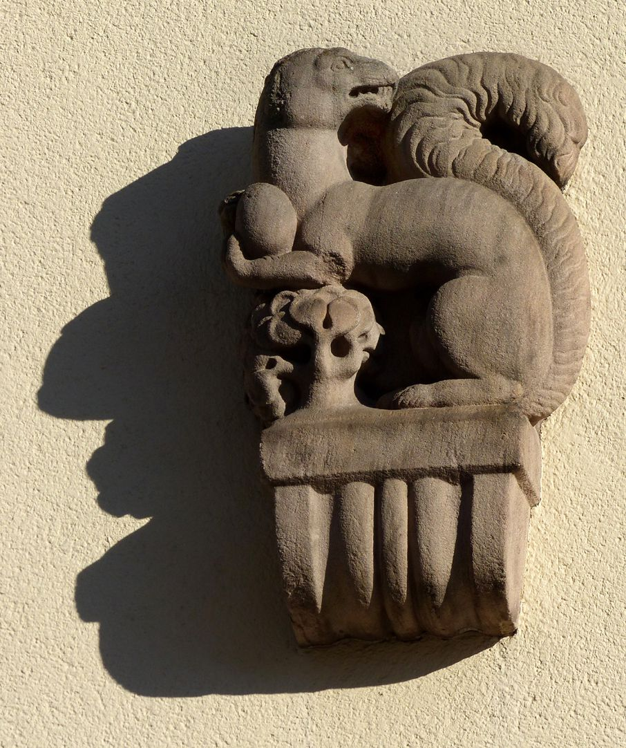 Former General Health Insurance Back front, Mühlgasse, corbel figure (squirrel with nut by Max Heilmeier)