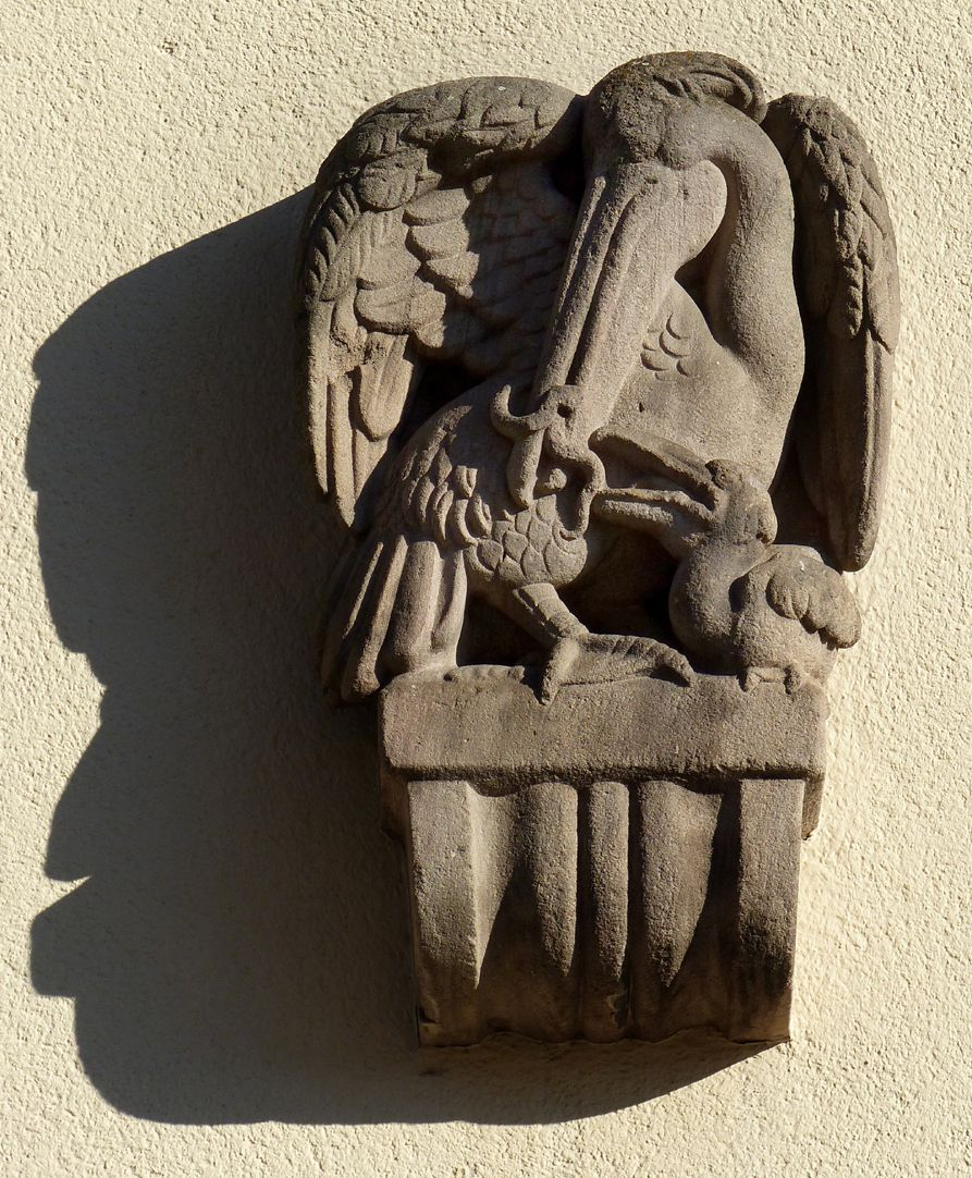 Former General Health Insurance Back front, Mühlgasse, corbel figure (pelican with fledgling by Max Heilmeier)