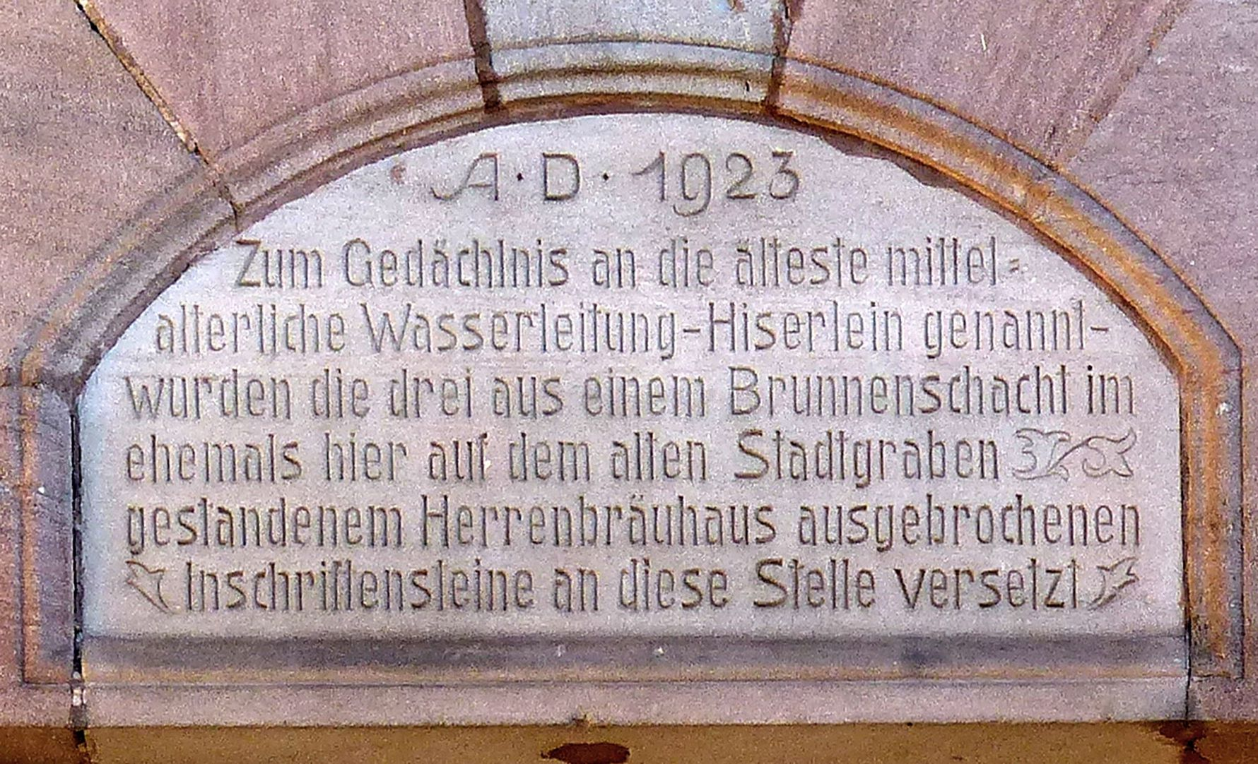 Former General Health Insurance Back front, Mühlgasse, panel with inscription of 1923