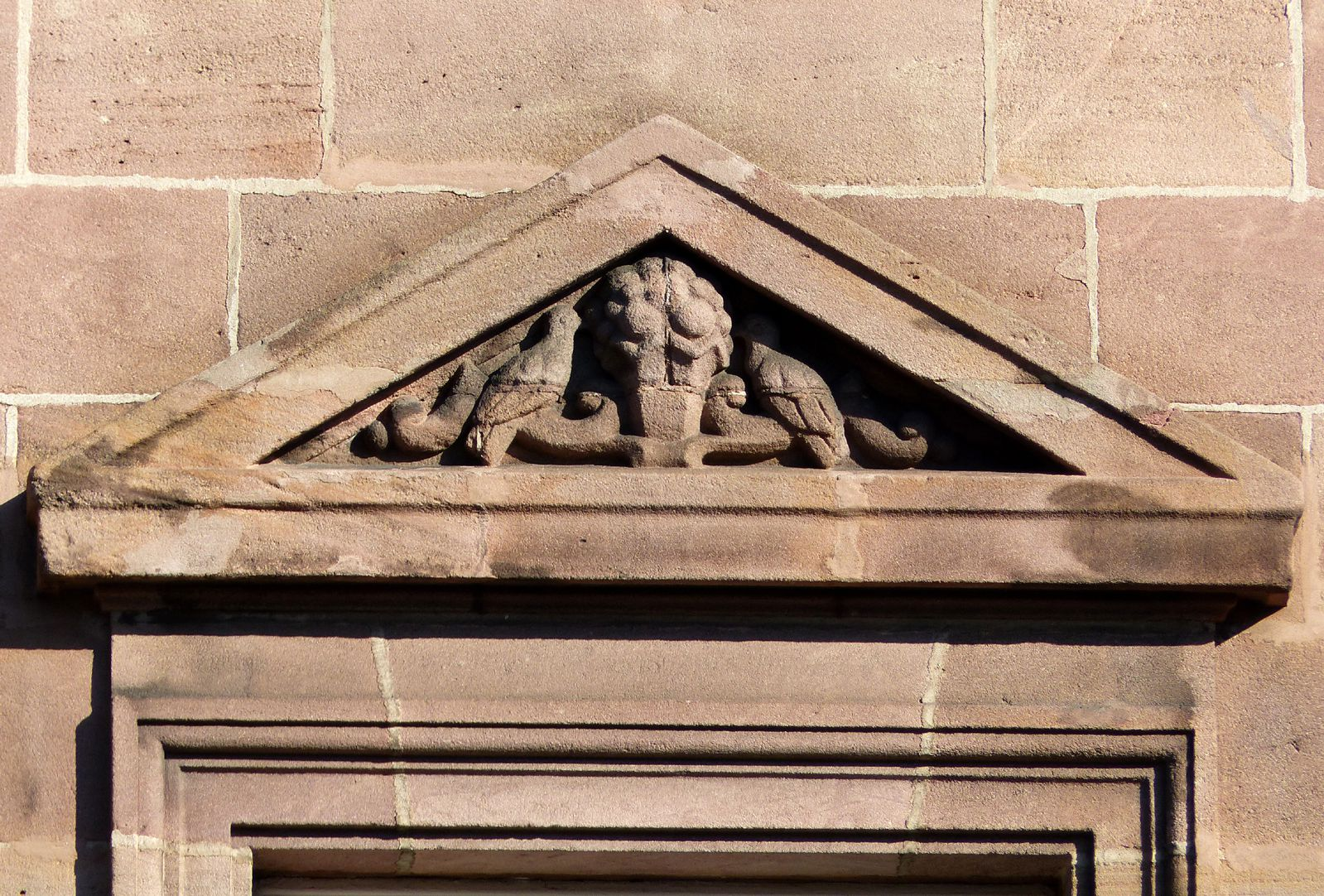Former General Health Insurance Triangular pediment with fruit basket and birds