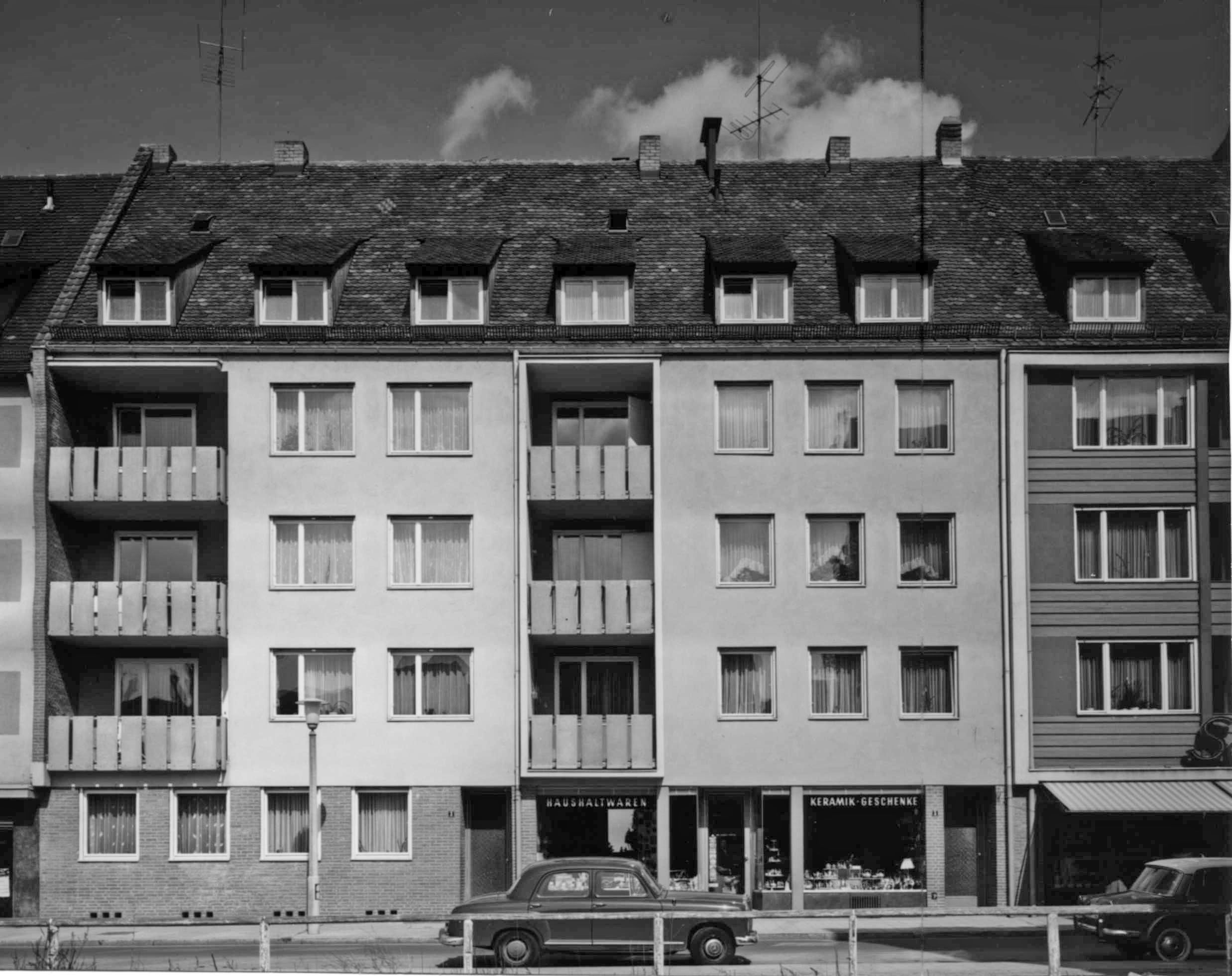 Residential and commercial buildings Built in the style of the neighbouring house with abandonment of the horizontal grooves