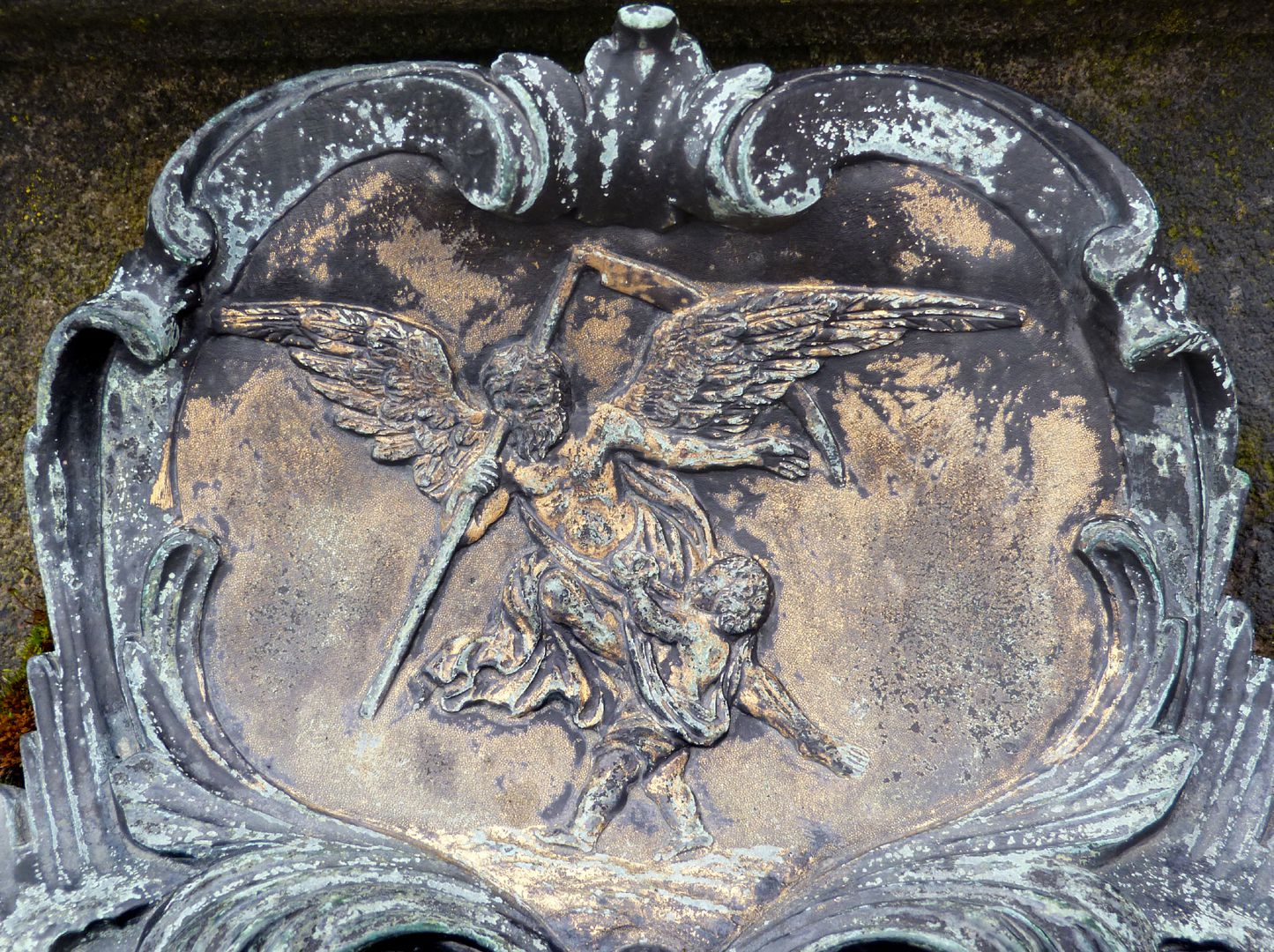 Tomb of Daniel Weidner and his spouse Maria Regina Leutner Rococo cartouche at the west side, winged death with sickle taking a child