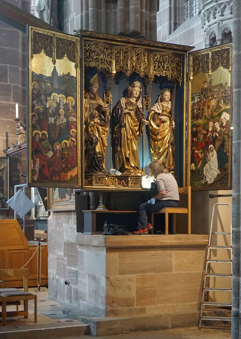 St Catherine's reredos of Levinus Memminger Restorer sitting on the mensa illustrates the size relationship to the figures of the altar.