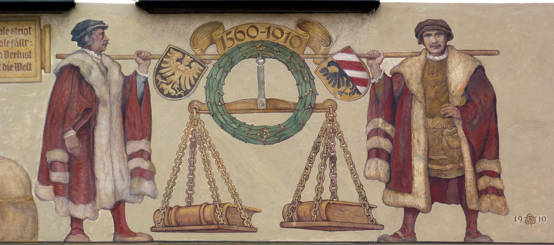 Merchants´trail South front, bearers of the weighing scale with coat of arms
