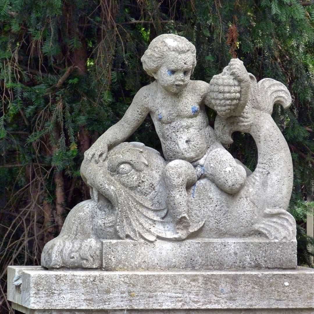Pomona Fountain Boy with grapes on a dolphin