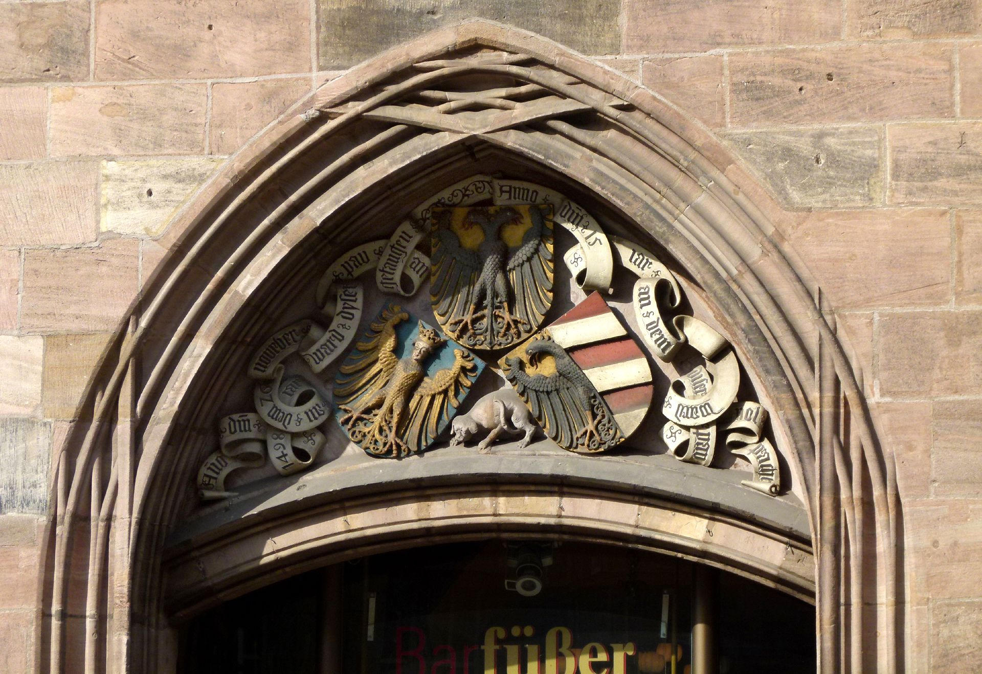 Tri-fold associated coat of arms Tri-fold associated coat of arms over the east portal