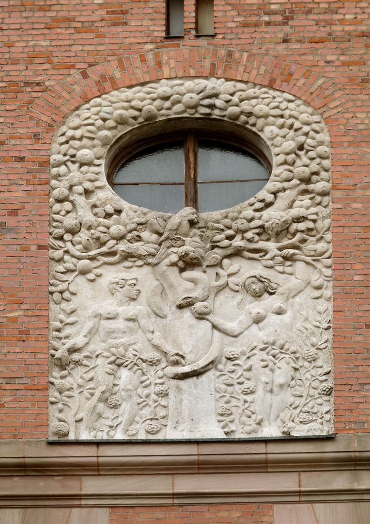 Dr. Theo-Schöller-School Relief on the twin gables: Adam and Eve (reaching out for the fruit on knowledge)