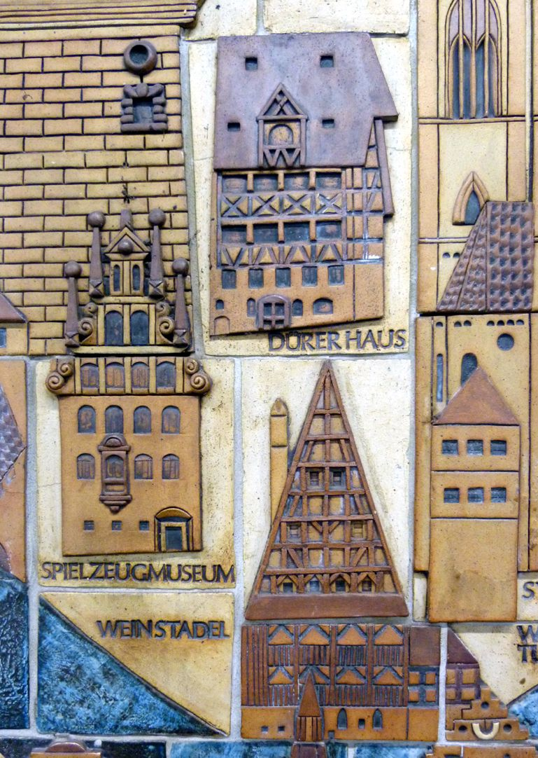 Ceramic relief of the Nuremberg Old City Detail: Weinstadel, Toy Museum, Durer House