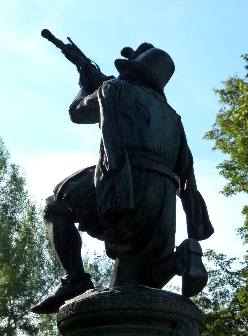 Crossbowman fountain Figure, against the light