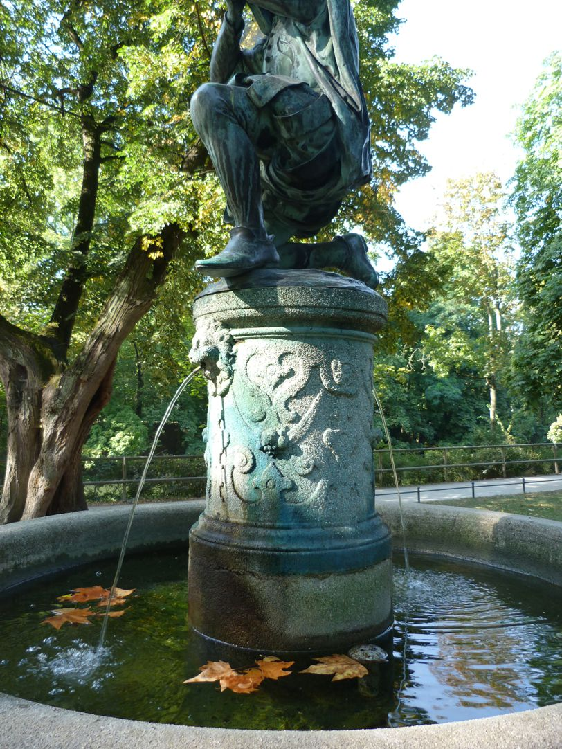 Crossbowman fountain Fountain pillar and basin