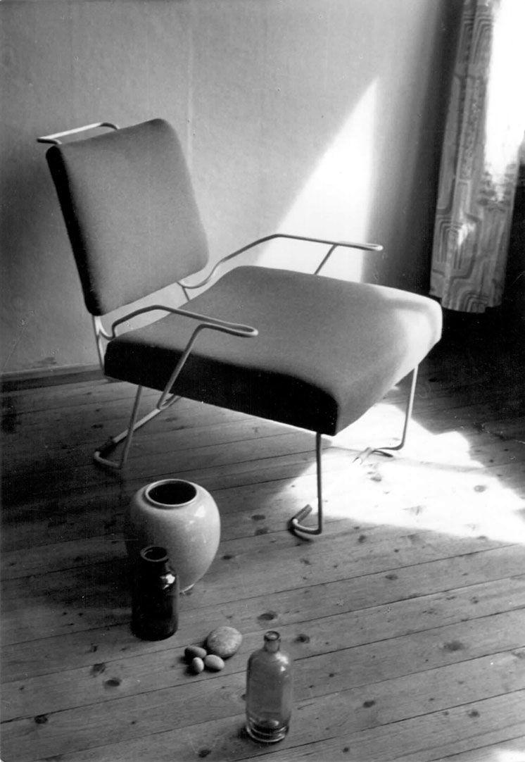 Armchair, lamp, table