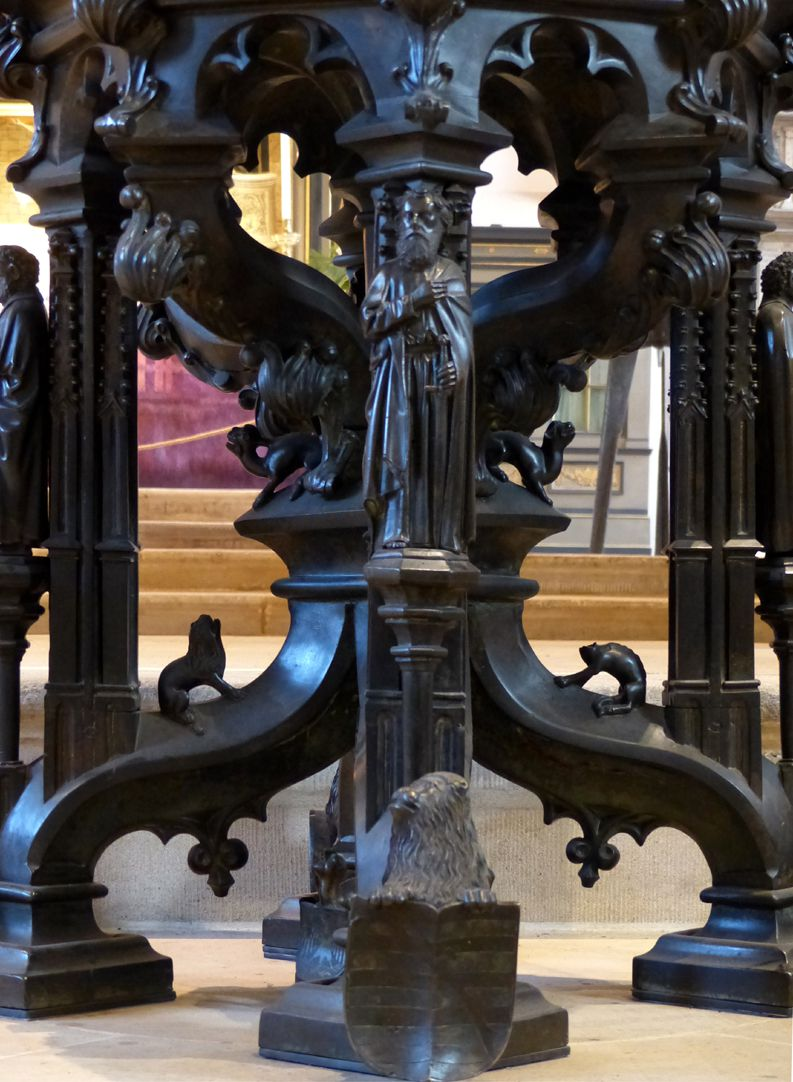 Baptismal font S-shaped buttresses and counter braces form the basis of the font.
