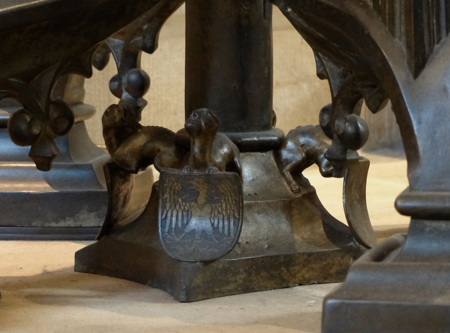 Baptismal font Central pillar basis with mythical creature as carrier of the imperial coat of arms