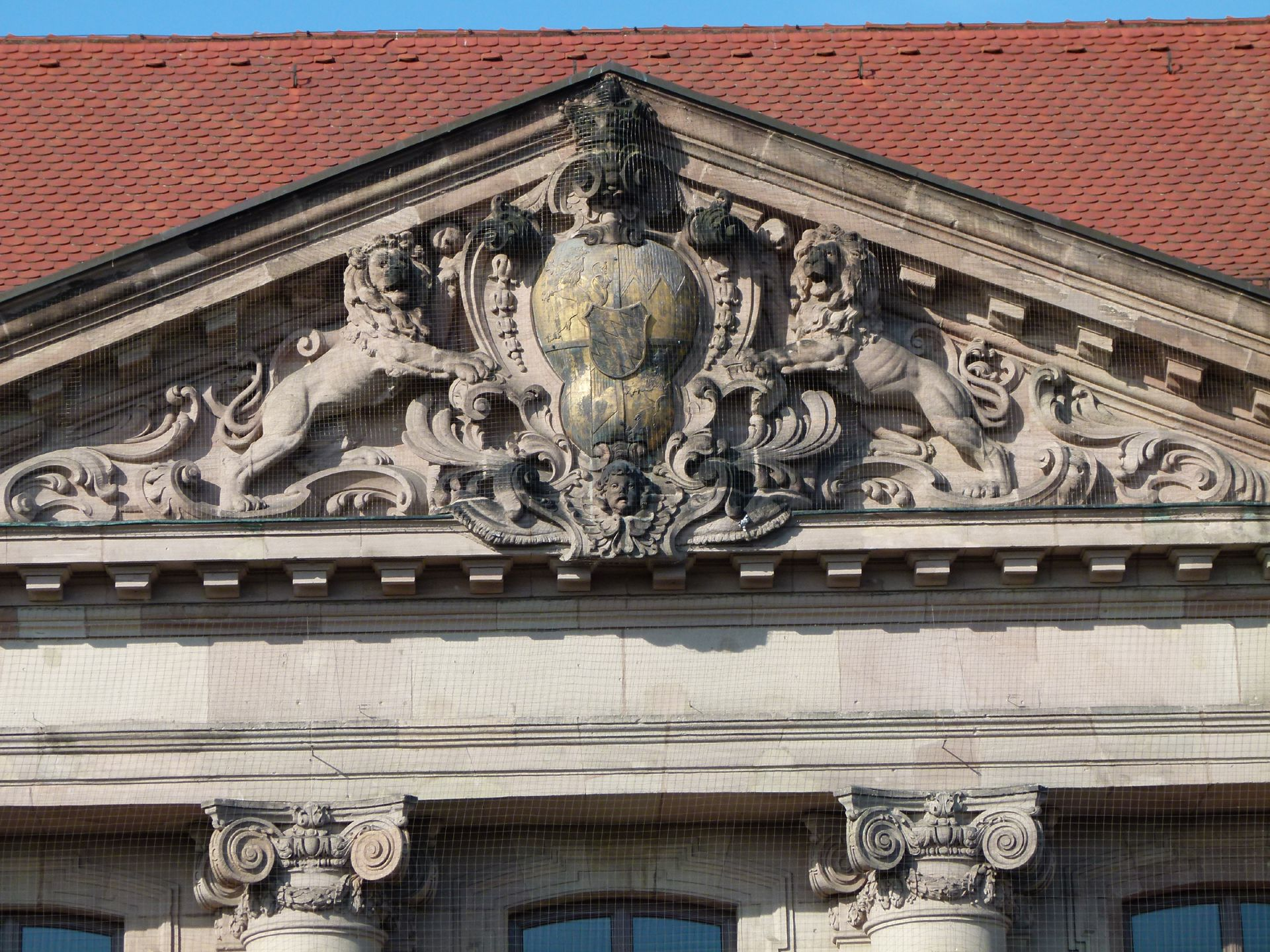 Former Bavarian Trade and Business Institute (Landesgewerbeanstalt) Main entrance front, northeast, gable with coat of arms carried by lions
