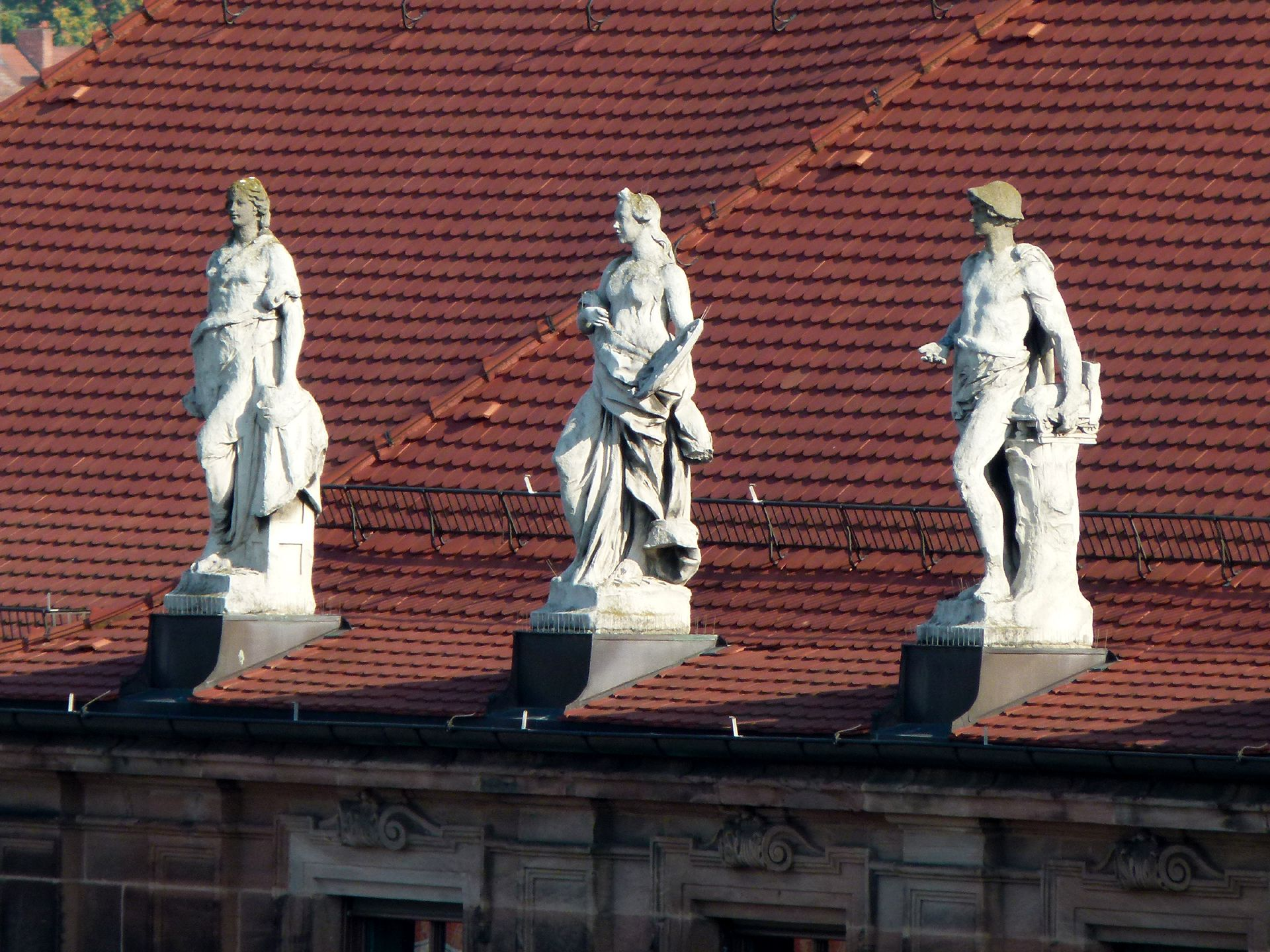 "Former Bavarian Trade and Business Institute (Landesgewerbeanstalt) Southwest front, median risalit, three allegoric statues of the ""branches of technology"" by Joseph Kramer"