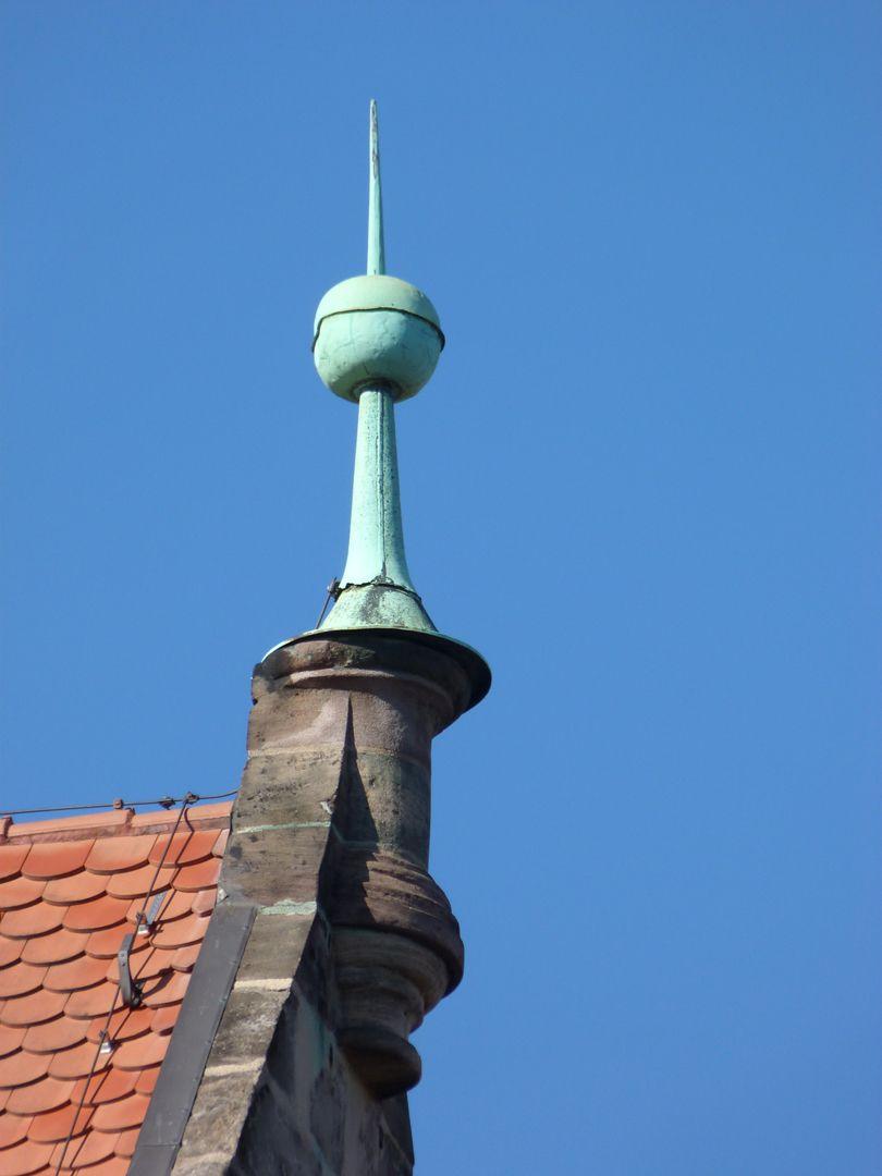 Master Builder House Gable crown of the east gable dormer with pommel